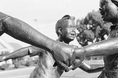 Ring Around the Rosie statue