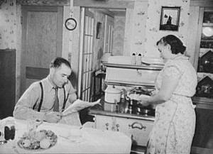depression-Captain Riberia waits for his wife to prepare supper. 1942